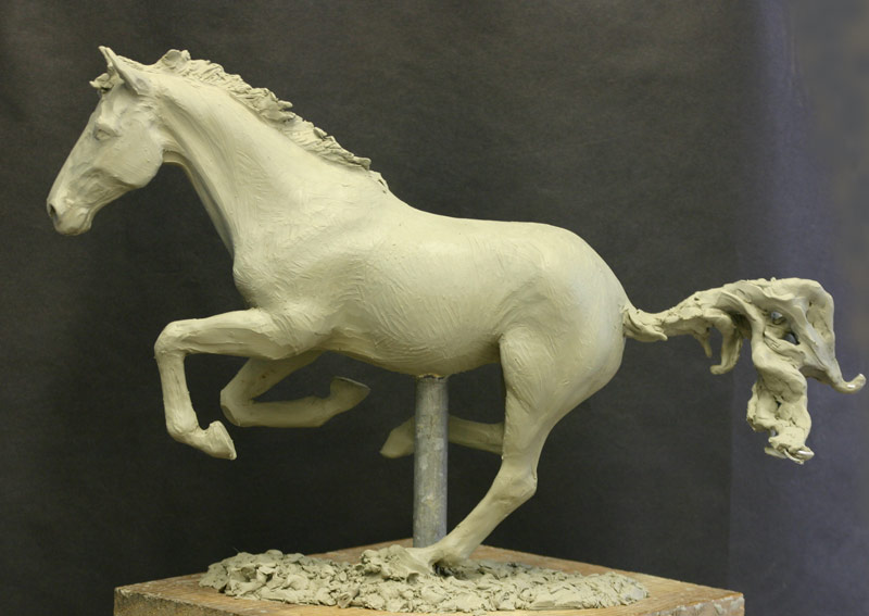 Galloping horse sculpture in clay